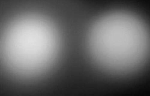 Óptica Extensiva contra reflectores de alto contraste